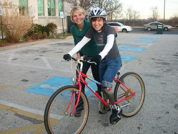 Julie poses with Rebecca back on her bike.